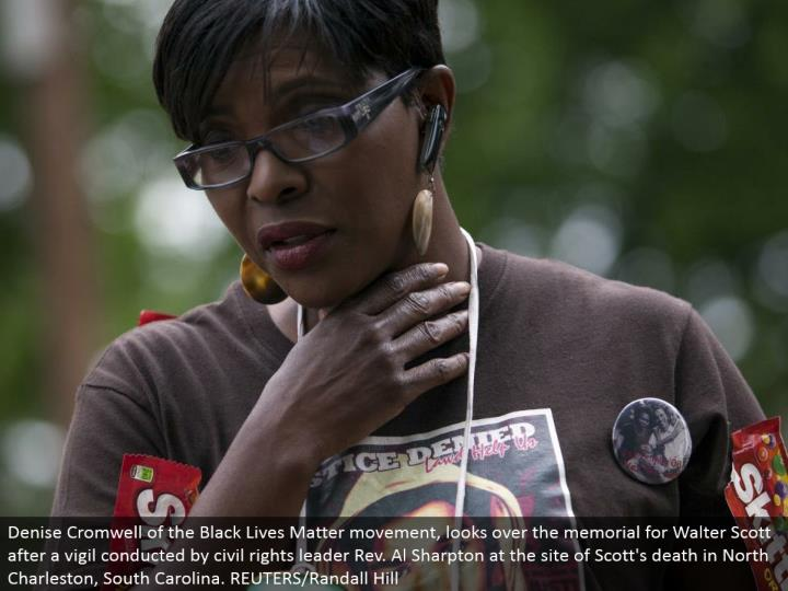 Denise Cromwell of the Black Lives Matter advancement, researches the recognition for Walter Scott after a vigil drove by social fairness pioneer Rev. Al Sharpton at the site of Scott's going in North Charleston, South Carolina. REUTERS/Randall Hill