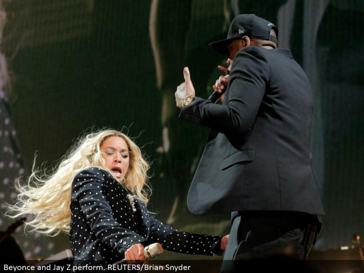 Beyonce and Jay Z perform. REUTERS/Brian Snyder