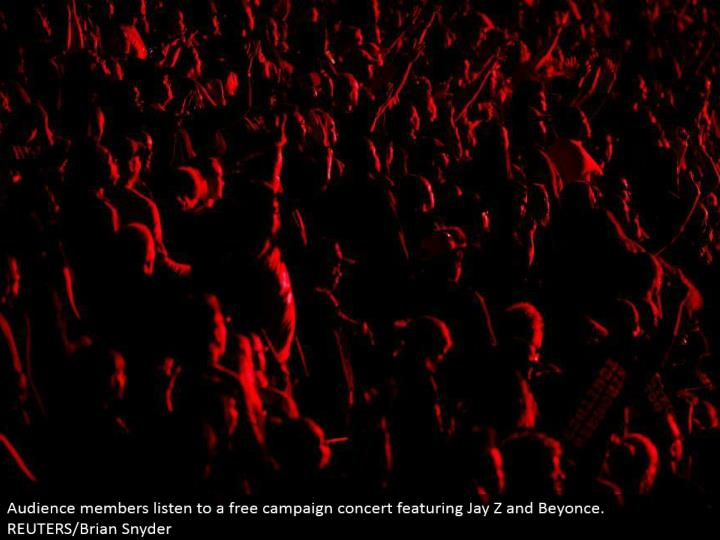 Audience individuals listen to a free crusade show including Jay Z and Beyonce. REUTERS/Brian Snyder