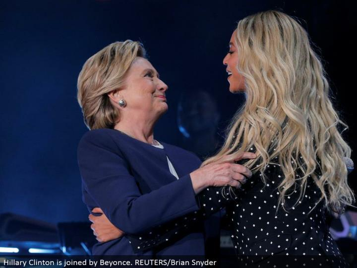 Hillary Clinton is joined by Beyonce. REUTERS/Brian Snyder