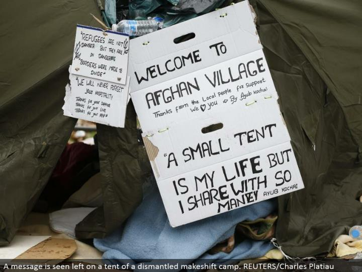 A message is seen left on a tent of a disassembled temporary camp. REUTERS/Charles Platiau