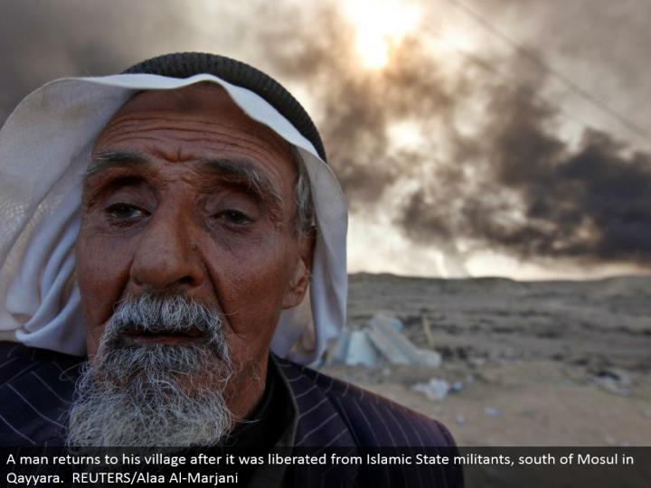 A man comes back to his town after it was freed from Islamic State aggressors, south of Mosul in Qayyara. REUTERS/Alaa Al-Marjani