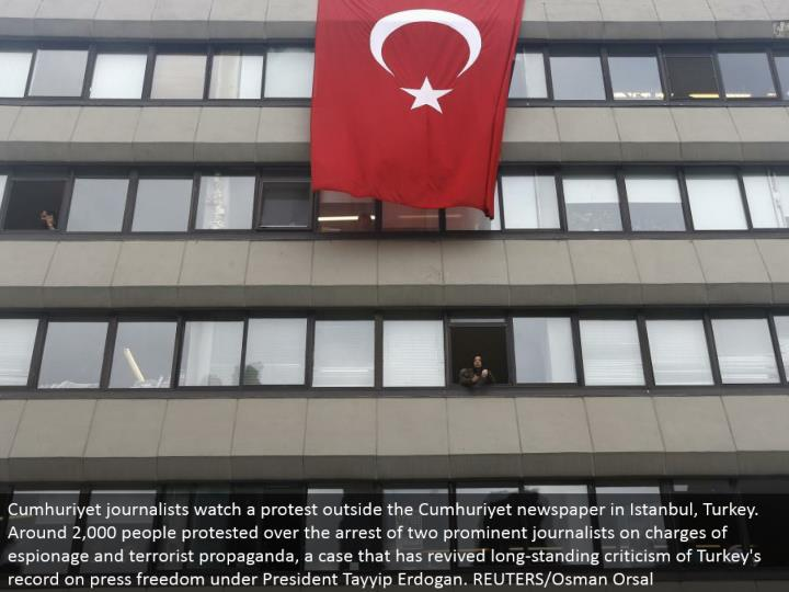 Cumhuriyet writers watch a challenge outside the Cumhuriyet daily paper in Istanbul, Turkey. Around 2,000 individuals challenged over the capture of two unmistakable columnists on charges of reconnaissance and fear monger promulgation, a case that has resuscitated long-standing feedback of Turkey's record on squeeze opportunity under President Tayyip Erdogan. REUTERS/Osman Orsal