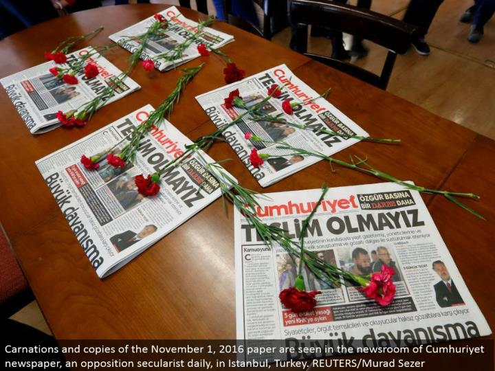 Carnations and duplicates of the November 1, 2016 paper are found in the newsroom of Cumhuriyet daily paper, a restriction secularist day by day, in Istanbul, Turkey. REUTERS/Murad Sezer