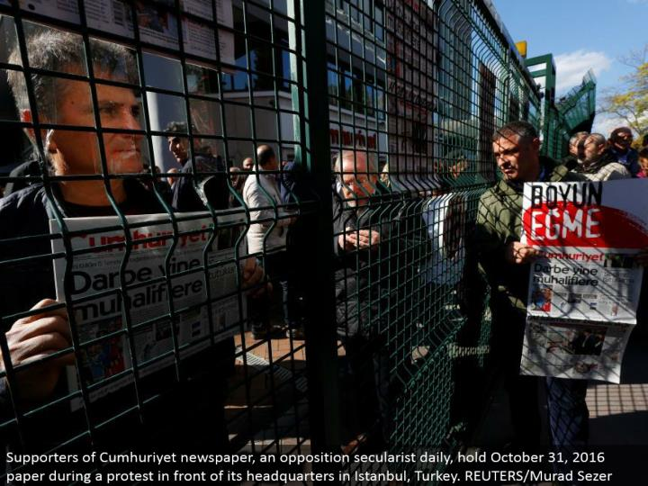 Supporters of Cumhuriyet daily paper, a restriction secularist day by day, hold October 31, 2016 paper amid a challenge before its base camp in Istanbul, Turkey. REUTERS/Murad Sezer