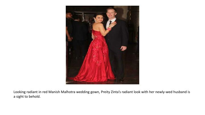 Looking radiant in red Manish Malhotra wedding gown,
