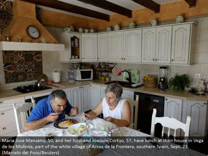 Maria Jose Manzano, 50, and her significant other Joaquin Cortijo, 57, eat at their home in Vega de los Molinos, part of the white town of Arcos de la Frontera, southern Spain, Sept. 23. (Marcelo del Pozo/Reuters)