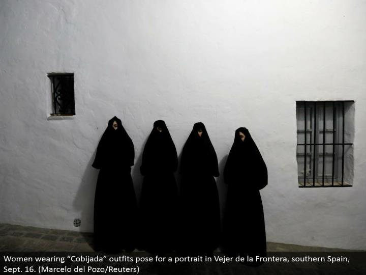 "Women wearing ""Cobijada"" outfits posture for a picture in Vejer de la Frontera, southern Spain, Sept. 16. (Marcelo del Pozo/Reuters)"