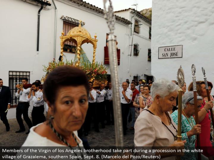 Members of the Virgin of los Angeles fraternity partake amid a parade in the white town of Grazalema, southern Spain, Sept. 8. (Marcelo del Pozo/Reuters)