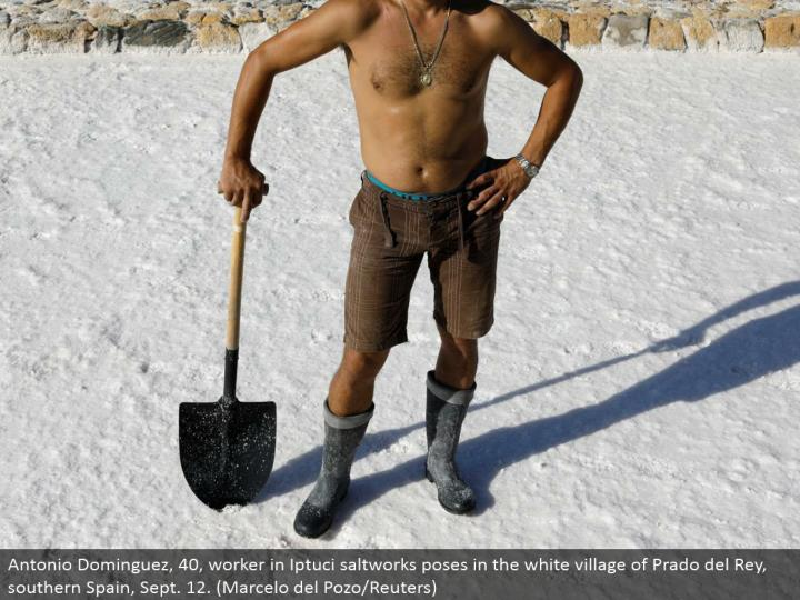 Antonio Dominguez, 40, specialist in Iptuci saltworks postures in the white town of Prado del Rey, southern Spain, Sept. 12. (Marcelo del Pozo/Reuters)