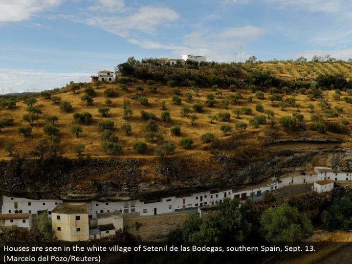 Houses are found in the white town of Setenil de las Bodegas, southern Spain, Sept. 13. (Marcelo del Pozo/Reuters)