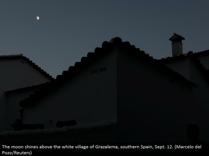 The moon sparkles over the white town of Grazalema, southern Spain, Sept. 12. (Marcelo del Pozo/Reuters)