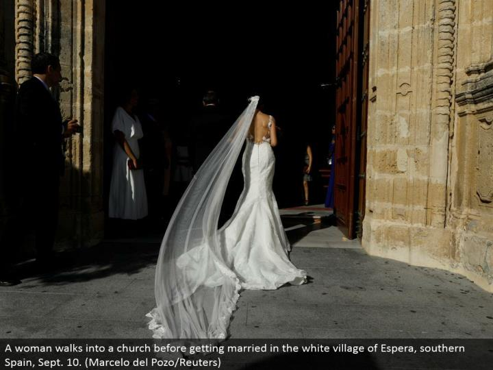 A lady strolls into a congregation before getting hitched in the white town of Espera, southern Spain, Sept. 10. (Marcelo del Pozo/Reuters)