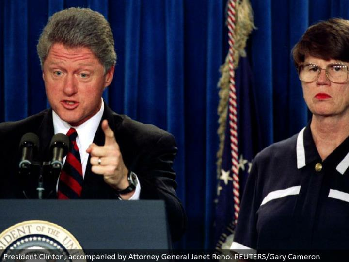 President Clinton, joined by Attorney General Janet Reno. REUTERS/Gary Cameron