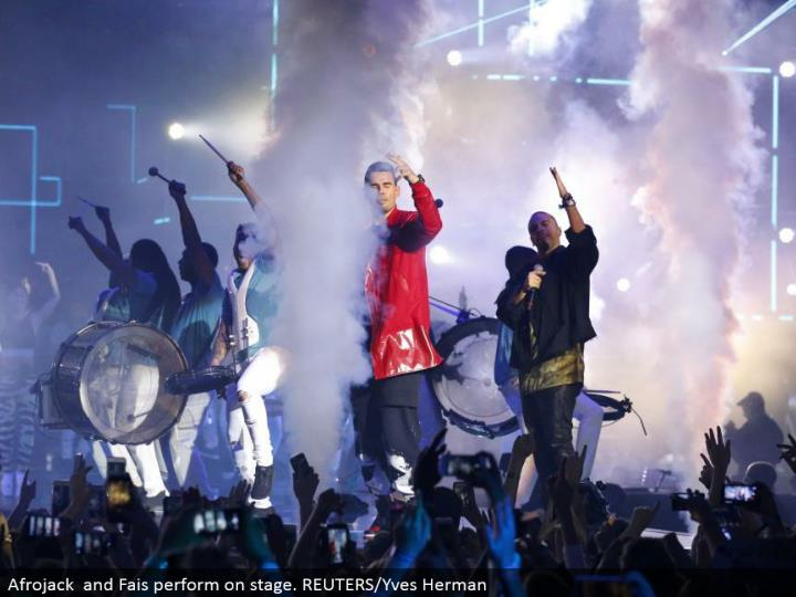 Afrojack and Fais perform in front of an audience. REUTERS/Yves Herman