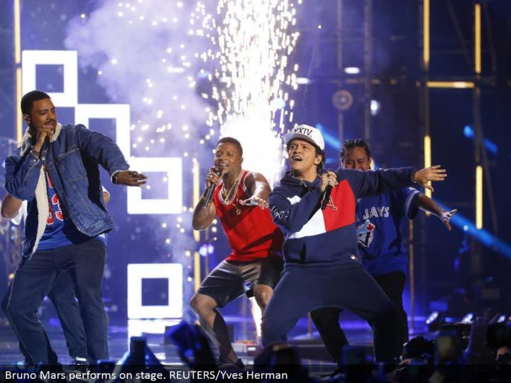 Bruno Mars performs in front of an audience. REUTERS/Yves Herman