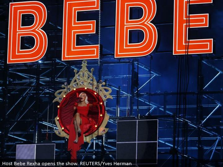 Host Bebe Rexha opens the show. REUTERS/Yves Herman