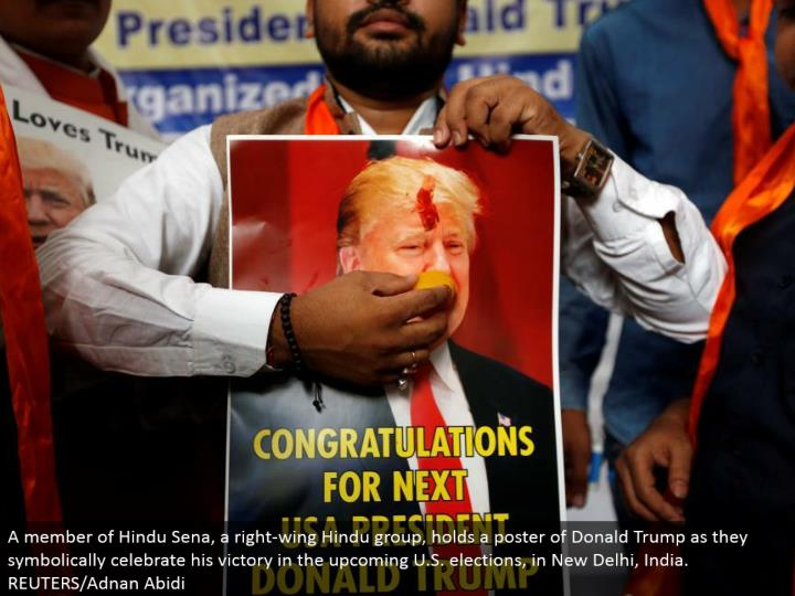 A individual from Hindu Sena, a conservative Hindu gathering, holds a publication of Donald Trump as they typically praise his triumph in the forthcoming U.S. races, in New Delhi, India. REUTERS/Adnan Abidi