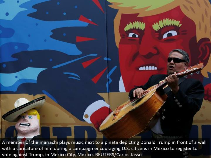 A individual from the mariachi plays music by a pinata delineating Donald Trump before a divider with a cartoon of him amid a battle empowering U.S. natives in Mexico to enlist to vote against Trump, in Mexico City, Mexico. REUTERS/Carlos Jasso