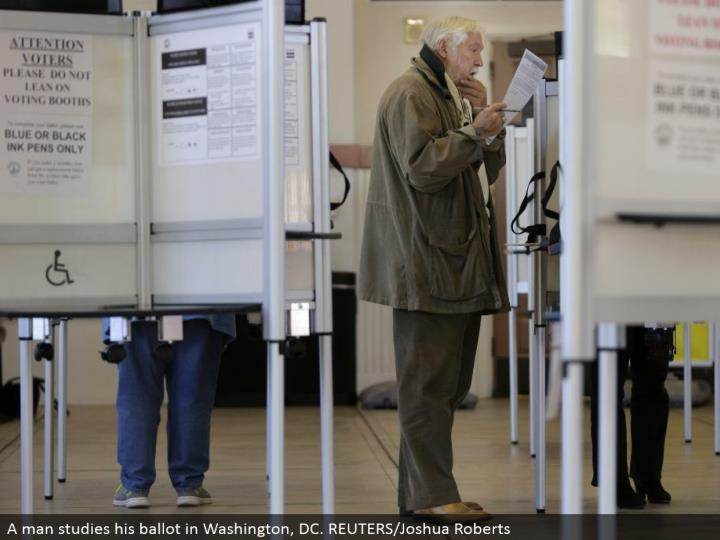 A man considers his poll in Washington, DC. REUTERS/Joshua Roberts