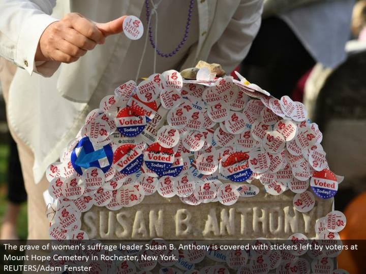 The grave of ladies' suffrage pioneer Susan B. Anthony is secured with stickers left by voters at Mount Hope Cemetery in Rochester, New York. REUTERS/Adam Fenster