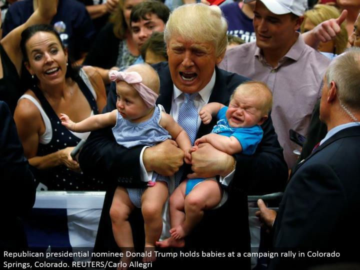 Republican presidential chosen one Donald Trump holds babies at a battle rally in Colorado Springs, Colorado. REUTERS/Carlo Allegri