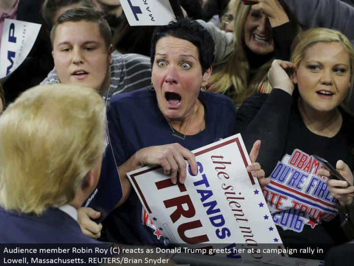 Audience part Robin Roy (C) responds as Donald Trump welcomes her at a battle rally in Lowell, Massachusetts. REUTERS/Brian Snyder