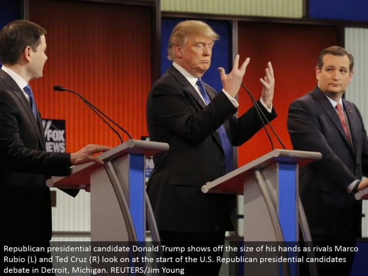 Republican presidential hopeful Donald Trump flaunts the measure of his hands as opponents Marco Rubio (L) and Ted Cruz (R) look on toward the begin of the U.S. Republican presidential applicants banter in Detroit, Michigan. REUTERS/Jim Young