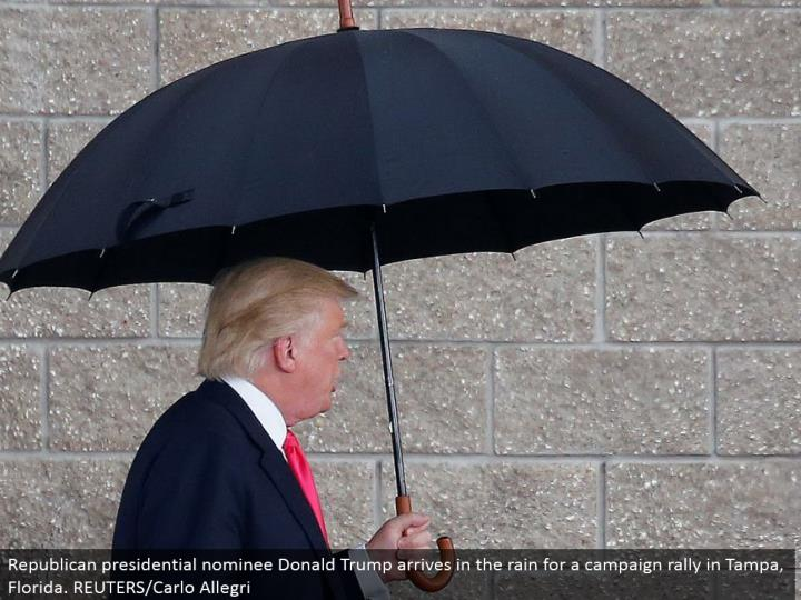 Republican presidential chosen one Donald Trump touches base in the rain for a crusade rally in Tampa, Florida. REUTERS/Carlo Allegri