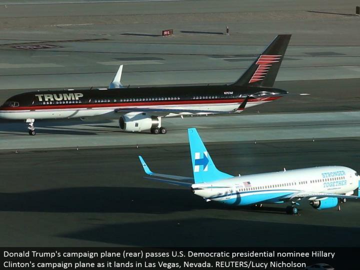 Donald Trump's battle plane (back) passes U.S. Majority rule presidential chosen one Hillary Clinton's battle plane as it terrains in Las Vegas, Nevada. REUTERS/Lucy Nicholson