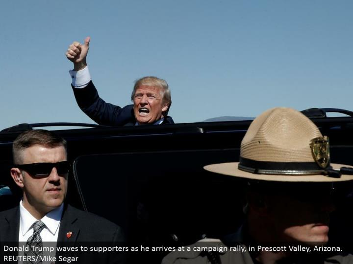 Donald Trump waves to supporters as he touches base at a crusade rally, in Prescott Valley, Arizona. REUTERS/Mike Segar