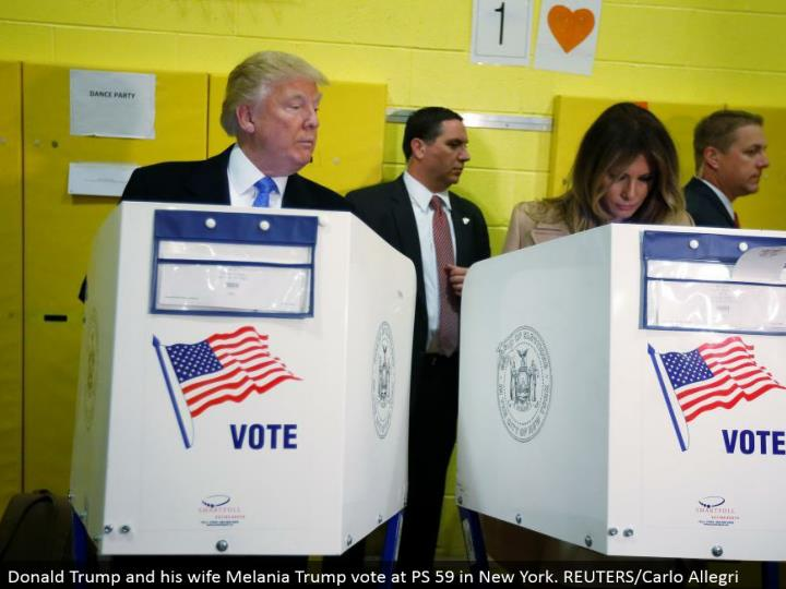 Donald Trump and his better half Melania Trump vote at PS 59 in New York. REUTERS/Carlo Allegri
