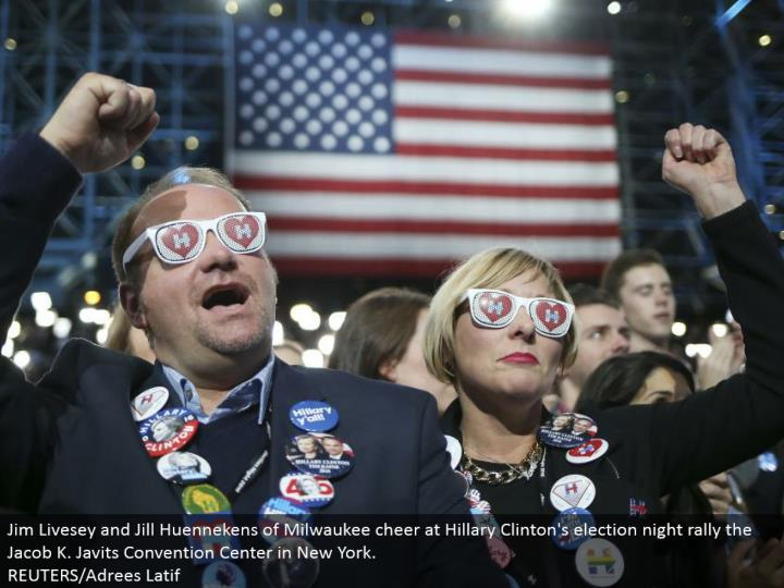 Jim Livesey and Jill Huennekens of Milwaukee cheer at Hillary Clinton's decision night rally the Jacob K. Javits Convention Center in New York. REUTERS/Adrees Latif