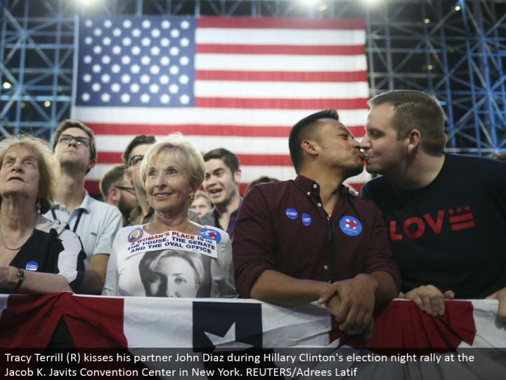 Tracy Terrill (R) kisses his accomplice John Diaz amid Hillary Clinton's decision night rally at the Jacob K. Javits Convention Center in New York. REUTERS/Adrees Latif