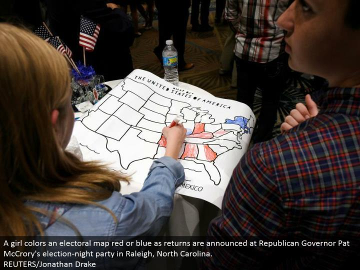 A young lady hues a constituent guide red or blue as returns are reported at Republican Governor Pat McCrory's decision night party in Raleigh, North Carolina. REUTERS/Jonathan Drake