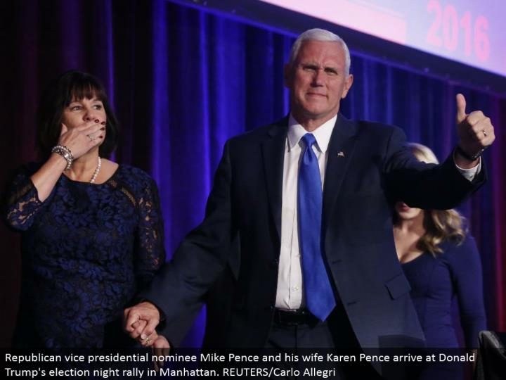 Republican bad habit presidential candidate Mike Pence and his significant other Karen Pence land at Donald Trump's decision night rally in Manhattan. REUTERS/Carlo Allegri