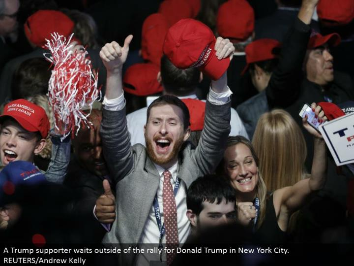 Supporters celebrate as returns come in for Donald Trump amid a race night rally in Manhattan. REUTERS/Mike Segar