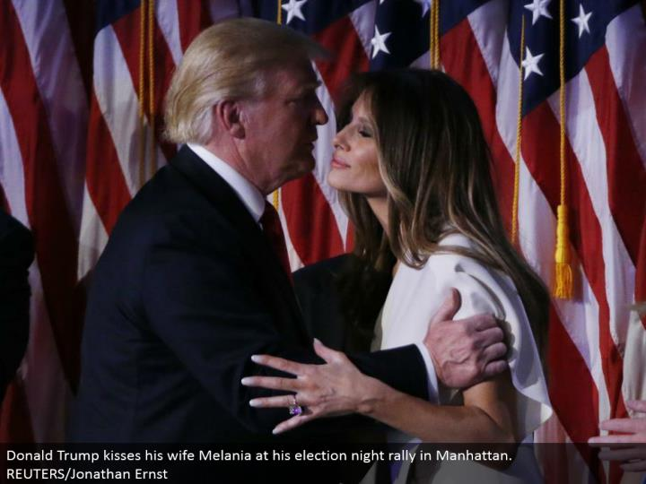 Donald Trump kisses his significant other Melania at his decision night rally in Manhattan. REUTERS/Jonathan Ernst