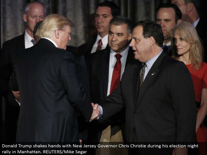 Donald Trump shakes hands with New Jersey Governor Chris Christie amid his decision night rally in Manhattan. REUTERS/Mike Segar