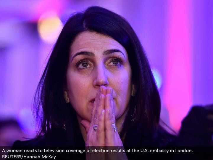 A lady responds to TV scope of decision results at the U.S. international safe haven in London.  REUTERS/Hannah McKay