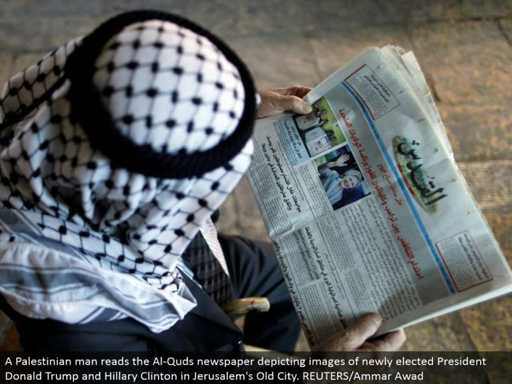 A Palestinian man peruses the Al-Quds daily paper delineating pictures of recently chose President Donald Trump and Hillary Clinton in Jerusalem's Old City. REUTERS/Ammar Awad