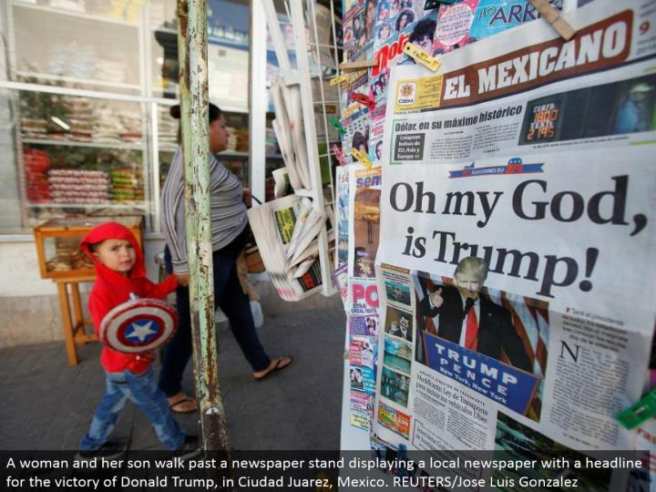 A lady and her child stroll past a daily paper stand showing a neighborhood daily paper with a feature for the triumph of Donald Trump, in Ciudad Juarez, Mexico. REUTERS/Jose Luis Gonzalez