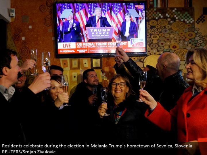 Residents celebrate amid the decision in Melania Trump's main residence of Sevnica, Slovenia. REUTERS/Srdjan Zivulovic