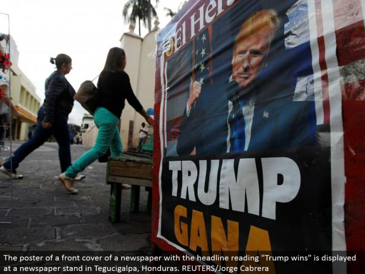 """The publication of a title page of a daily paper with the feature perusing """"Trump wins"""" is shown at a daily paper remain in Tegucigalpa, Honduras. REUTERS/Jorge Cabrera"""