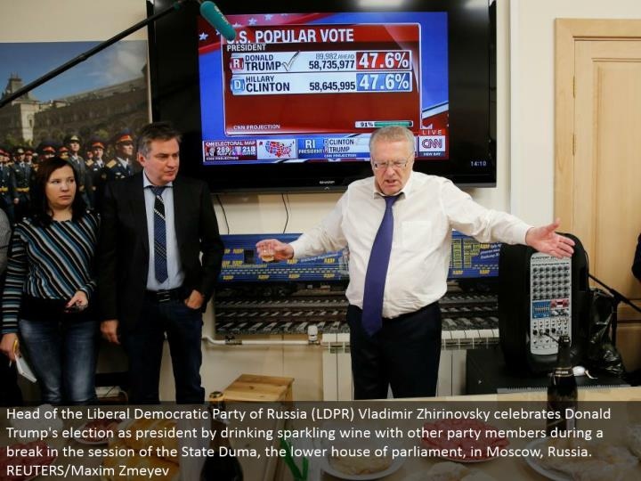 Head of the Liberal Democratic Party of Russia (LDPR) Vladimir Zhirinovsky observes Donald Trump's race as president by drinking shimmering wine with other gathering individuals amid a break in the session of the State Duma, the lower place of parliament, in Moscow, Russia. REUTERS/Maxim Zmeyev