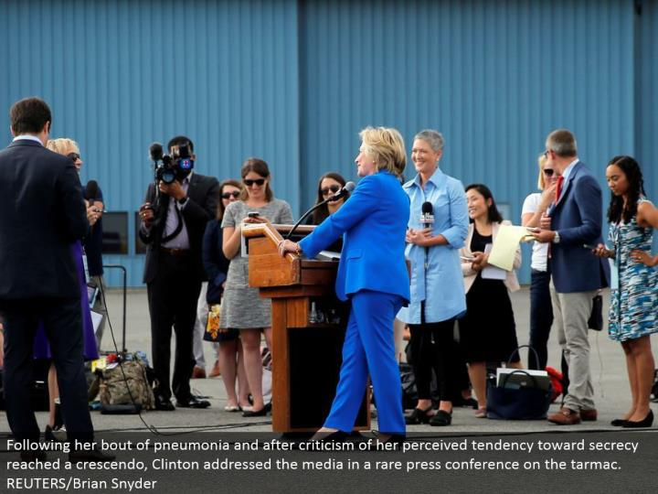 Following her episode of pneumonia and after feedback of her apparent inclination toward mystery achieved a crescendo, Clinton tended to the media in an uncommon question and answer session on the landing area. REUTERS/Brian Snyder