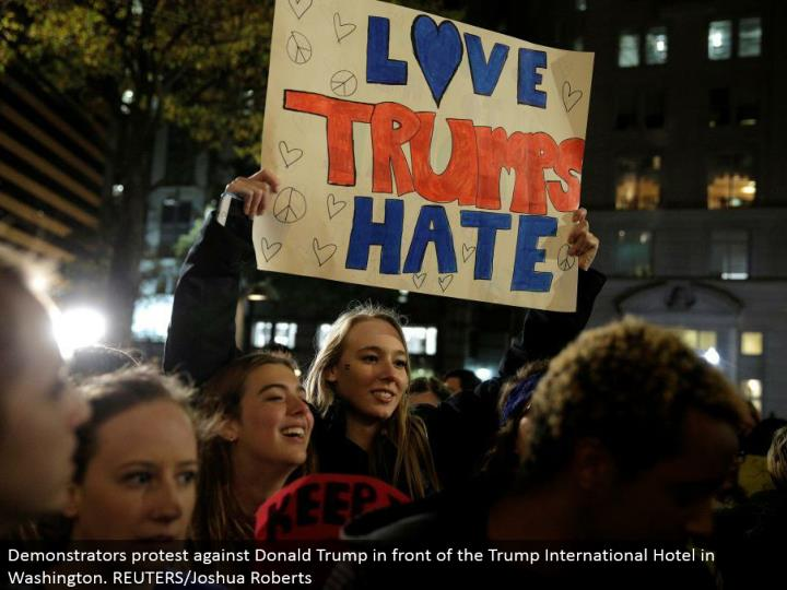Demonstrators challenge Donald Trump before the Trump International Hotel in Washington. REUTERS/Joshua Roberts