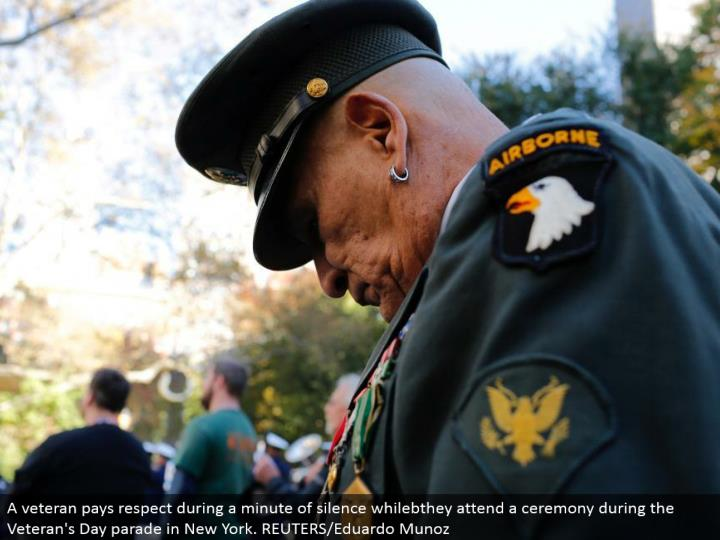 A veteran pays regard amid a moment of hush whilebthey go to a function amid the Veteran's Day parade in New York. REUTERS/Eduardo Munoz