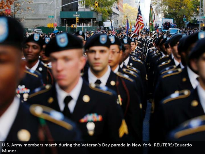 U.S. Armed force individuals walk amid the Veteran's Day parade in New York. REUTERS/Eduardo Munoz