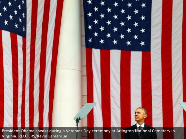 President Obama talks amid a Veterans Day service at Arlington National Cemetery in Virginia. REUTERS/Kevin Lamarque